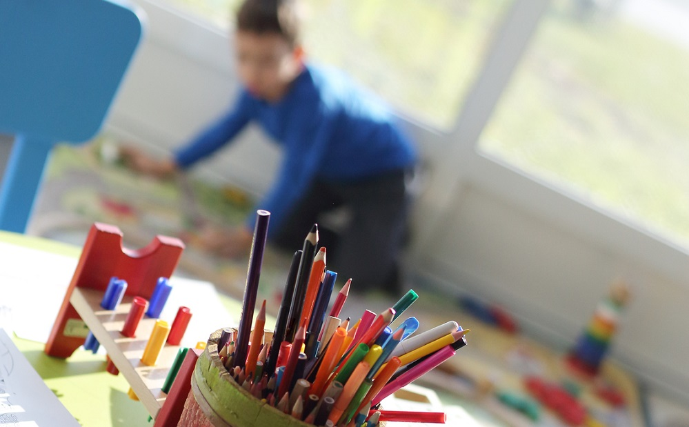 Child drawing in classroom