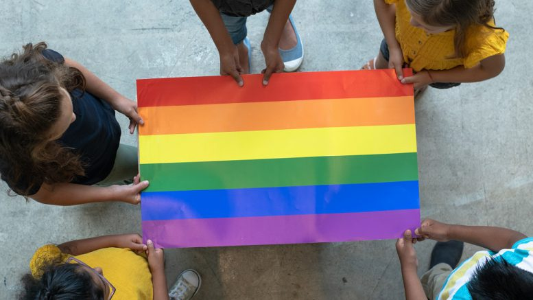 pride flag with students